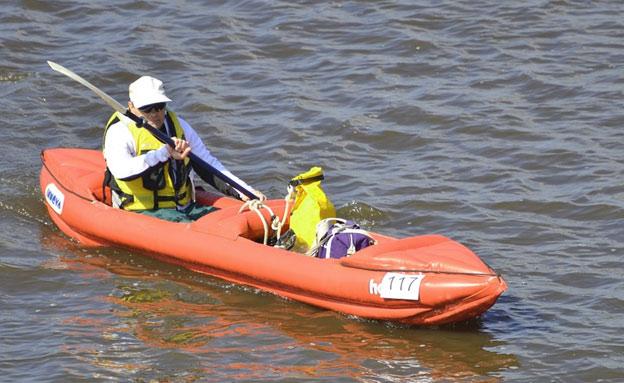 Guy In Inflatable Kayak