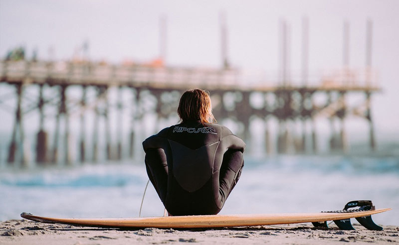 Guy Resting From Surfing