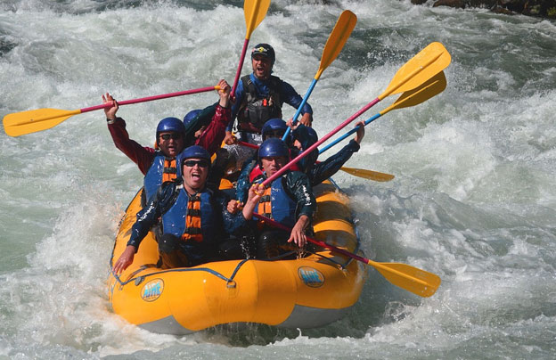 Guys Rafting in Inflatable Boat