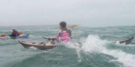 Two men sea kayaking