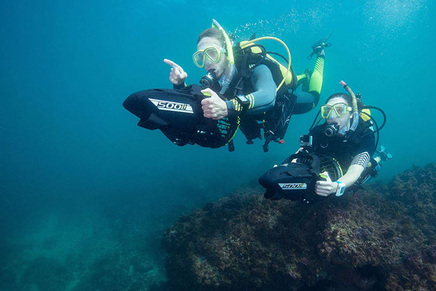 Two Divers Using a Yamaha Underwater Scooter