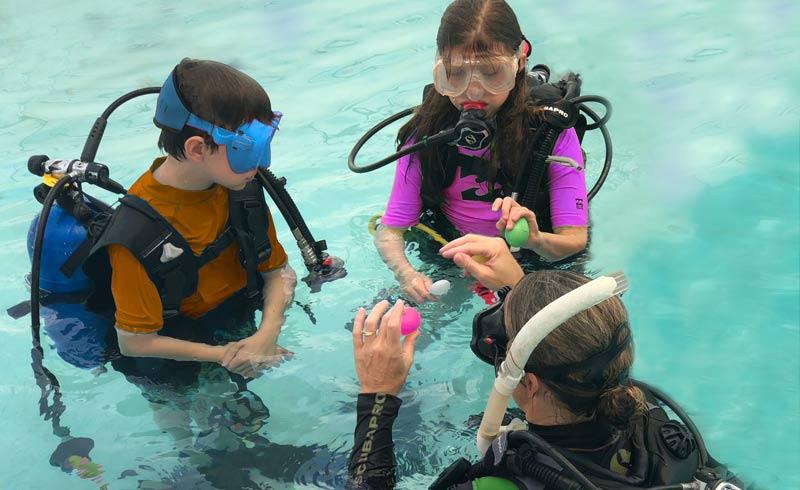 teaching kids in pool