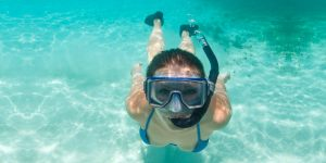 woman diving with snorkel mask
